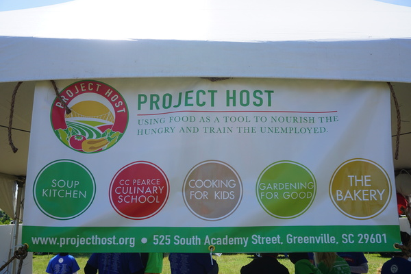 "The Project Host banner which says ""Project Host, Using food as a tool to nourish the hungry and train the unemployed"""